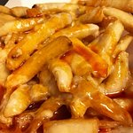 Volcano Fries made with our wing sauce and blend of pizza cheese