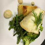 Daily special: cod fillet with potato gratin and sautéed greens