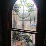 Spring flowers are creeping out through the downed leaves. Pic #2 Stained glass window in Castle