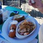 mixed fish and shrimp boat ..baked potato..hush puppies