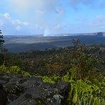 stone wall and smokiong volcano