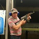 Posing with an AK47