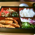 Yummy salmon teriyaki benton box.Noodles, rice, pickles, veg