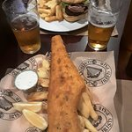 """""""House"""" burger with fries and Fish & Chips. Harps draught."""