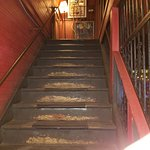 Staircase leading up to restaurant from the bar