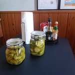 Free Pickles and Peppers On Each Table