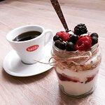 Yogurt, jam, oats and seasonal fruit