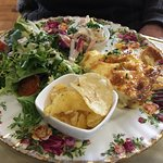 Quiche with chips, coleslaw and salad