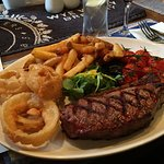 Johnny Morris 28 day aged sirloin steak, with chips, onion rings, mushrooms and cherry tomatoes