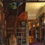 Beautiful entryway with original staircase and millwork
