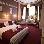 Delux Double Room 9 lovely size room with a glimt of the sea