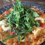 langoustine pizza with cherry tomatoes, arugula and garlic oil