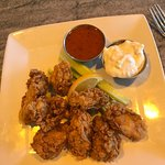 Fried oysters with spicy buffalo and chunky blue cheese sauces