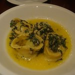 Spinach filled Tortellini served in a sauce of butter and basil