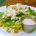 Delicious caesar salad topped with crabmeat