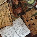 menus and cucumber water on a vintage inspired montage table