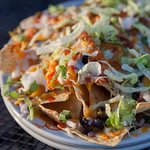 Loaded Nachos, which includes Black Olives, Tomatoes, Onions, Green Peppers, Jalapeños, & Lettuc
