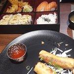 Vegetarian bento box with spring rolls