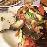 Amazing food! Stuffed squid and tomato salad bread bowl