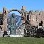 Modern sculpture of St Cuthbert by Fenwick Lawson