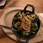 Brussels Sprouts with non-spicy chorizo and onion rings