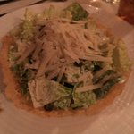Romaine lettuce with fried capers, croutons and shaved parmesan cheese tossed with a Caesar dres