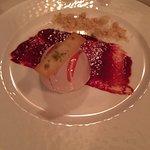 Cocolate Mousse and fresh raspberries with pistachio gelato