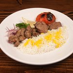 Tenderloin Kabob with tender cuts of Angus, served with saffron rice, charred tomato, lemon, on