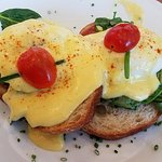 Hanford House Benny  slices of rustic bread w/ soppressata, wilted spinach, happy poached eggs,