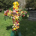The cross adorned with spring flowers, Easter Sunday 2018.