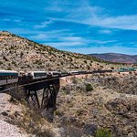 The Verde Canyon Railway train rounds a bend in the track, headed for Perkinsville.