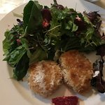 Crab cakes. Very moist and generously portioned salad with light vinegrette dressing.