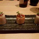 Sashimi roll - tuna, salmon and yellowtail wrapped in daikon topped with yuzu tobiko