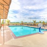 Outdoor rooftop pool and bar