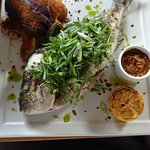whole roasted fish with smashed potatoes, julienned micro greeens