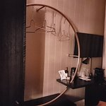 The hanging rail.is a stylish feature of the room