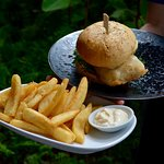 Locally sourced, Aussie Barra Burger with a side of chips.