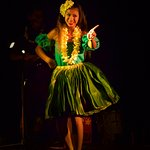 The traditional hula dance with fresh grass skirt