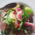 Late summer salad of delicate herbs and greens, citrus, chèvre, & prosciutto