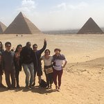 Giza pyramids with our tour guide, Ahmed
