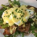 Toasted sourdough topped with asparagus, rocket, bacon and poached eggs and home made hollandais
