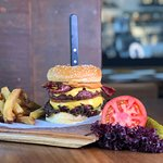 250 gr pure Black Angus cheese burger peri peri, veal bacon, caramelized onion, spicy tomato dip