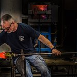 Demonstrating glass blowing-making a vase