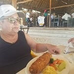 Enjoying a Fish Rellano stuffed with shrimp and crab.  It was delicious and a very hearty portio