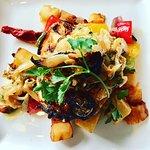 Chicken Supreme with fresh Rosemary, White Wine, Mediterranean Vegetables & Confit Garlic