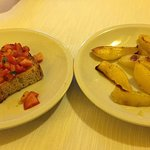 Our appertizers, authentic bruschetta and potato. Plain looking, but absolutely delicious!