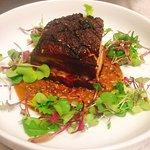Spicy pork belly over Madras Lentils