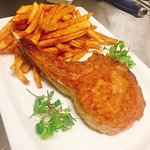 Pan seared veal chop with home made french fries and cranberry puree