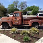 Old 300 truck out front.