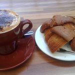 Large Soy Cappuccino and carefully sliced Berry Muffin